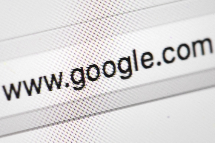 FILE- This April 26, 2017, file photo shows Google's web address, in Philadelphia. Google says it is going to ban advertisements for cryptocurrencies such as bitcoin, as well as related content like trading advice and cryptocurrency wallets. (AP Photo/Matt Rourke, File)