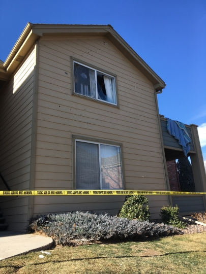 FILE - In this Jan. 1, 2018, file photo, Deputy Zack Parrish's a suburban Denver apartment building where he was fatally shot is riddled by bullet holes. Sheriff Tony Spurlock's office used social media heavily after Parrish's death, including a dramatic video posted to Facebook using body camera footage and other material to explain what led up to the shooting. (AP Photo/Colleen Slevin, File)