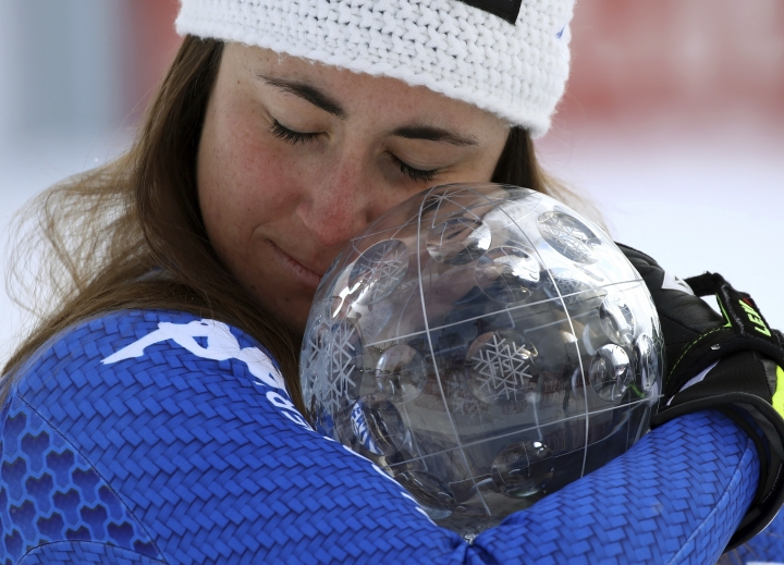 Italy's Sofia Goggia holds the women's World Cup downhill discipline trophy, at the alpine ski World Cup finals in Are, Sweden, Wednesday, March 14, 2018. (AP Photo/Marco Trovati)