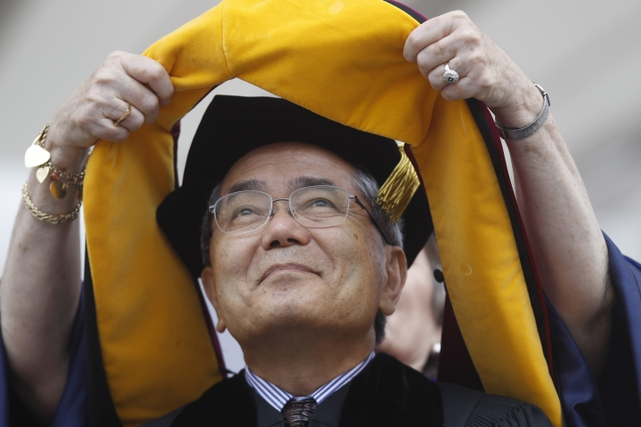 FILE - In this May 16, 2011 file photo, Nobel Prize winning chemistry professor Ei-ichi Negishi, of Japan, receives an honorary degree at the University of Pennsylvania's 255th Commencement, in Philadelphia. Authorities in northern Illinois are investigating the death of Negishi's wife, whose body was found at a landfill hours after the couple were reported missing in Indiana. (AP Photo/Matt Rourke, File)