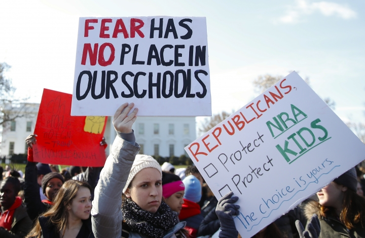 Students rally in front of the White House in Washington, Wednesday, March 14, 2018. Students walked out of school to protest gun violence in the biggest demonstration yet of the student activism that has emerged in response to last month's massacre of 17 people at Florida's Marjory Stoneman Douglas High School. (AP Photo/Carolyn Kaster)