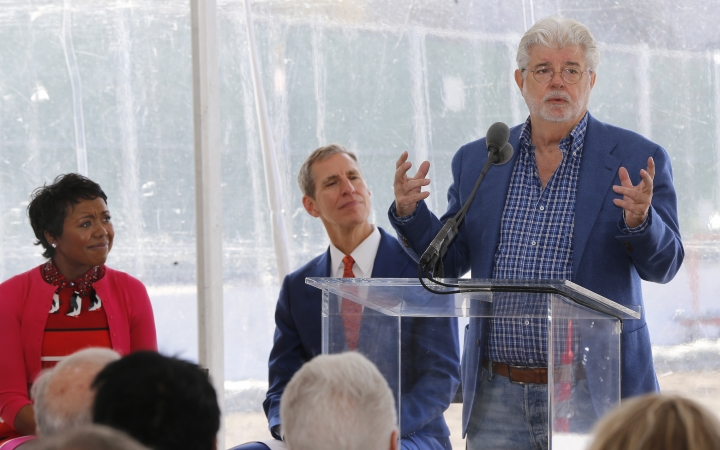 """Star Wars"" creator filmmaker George Lucas, right, and his wife Mellody Hobson, left, and Don Bacigalupi, Founding President, center, attend the groundbreaking ceremony of the on his $1.5 billion Lucas Museum of Narrative Art in Los Angeles Wednesday, March 14, 2018. . The institution, scheduled to open in 2021, is envisioned as not just a repository for ""Star Wars"" memorabilia but a wide-ranging museum representing all forms of visual storytelling from paintings and drawings to comic strips and digital and traditional films. (AP Photo/Damian Dovarganes)"
