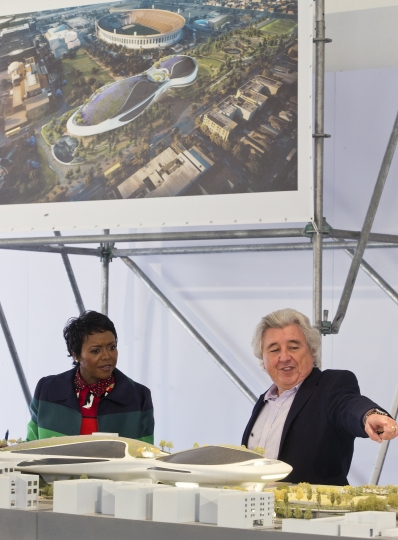 "Mellody Hobson, Co-Founder, Lucas Museum of Narrative Art looks at an architectural model of the museum with Angelo Garcia, president of Lucas Real Estate Holdings and vice president of the museum, right, before breaking ground in Los Angeles Wednesday, March 14, 2018. The institution, scheduled to open in 2021, is envisioned as not just a repository for George Lucas' ""Star Wars"" memorabilia but a wide-ranging museum representing all forms of visual storytelling from paintings and drawings to comic strips and digital and traditional films. (AP Photo/Damian Dovarganes)"