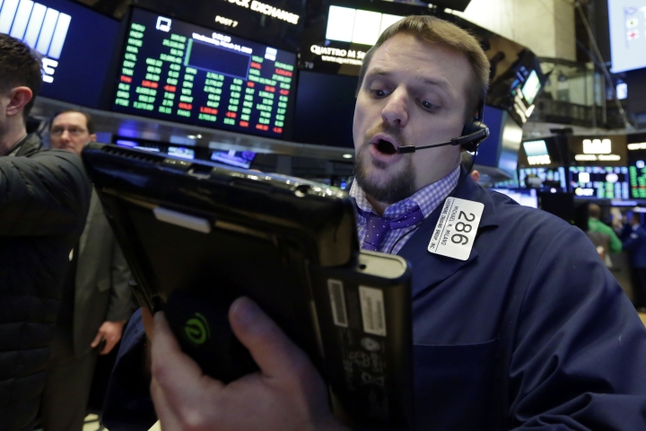 Trader Michael Milano works on the floor of the New York Stock Exchange, Wednesday, March 14, 2018. U.S. stocks are edging lower Wednesday morning as Boeing and other industrial companies take losses. (AP Photo/Richard Drew)