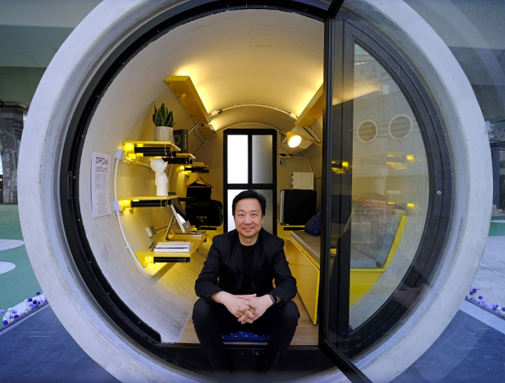In this Tuesday, March 13, 2018, photo, architect James Law poses during an interview at his OPod tube house in Hong Kong's industrial area of Kwun Tong. Hong Kong's notoriously expensive housing makes owning an affordable home a pipe dream for many residents. But the local architect proposed a novel idea to help alleviate the problem: building stylish micro-apartments inside giant concrete drainage pipes. (AP Photo/Vincent Yu)