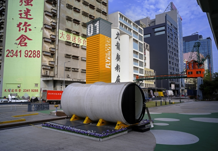 """This Tuesday, March 13, 2018, photo shows an OPod tube home created by architect James Law at Hong Kong's industrial area of Kwun Tong. Hong Kong's notoriously expensive housing makes owning an affordable home a pipe dream for many residents. But the local architect proposed a novel idea to help alleviate the problem: building stylish micro-apartments inside giant concrete drainage pipes. At 100 square feet (9.3 square meters) the tube houses are not that much smaller than Hong Kong's infamous """"cubicle homes"""" - older apartments subdivided into cramped and squalid living spaces. (AP Photo/Vincent Yu)"""