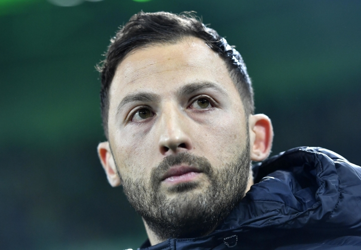 FILE - In this Dec. 9, 2017 file photo Schalke's head coach Domenico Tedesco watches during the German Bundesliga soccer match between Borussia Moenchengladbach and FC Schalke 04 in Moenchengladbach, Germany. With eight games of the season remaining, Tedesco's side is best-placed for a return to the Champions League along with soon-to-be-crowned champion Bayern Munich. (AP Photo/Martin Meissner, file)