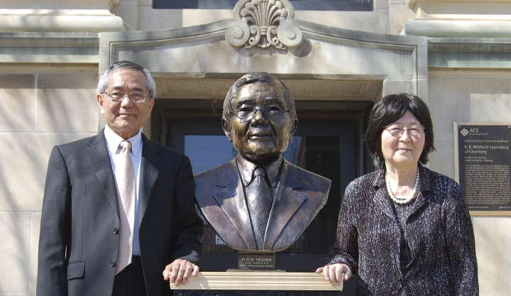 In this April 18, 2014, file photo, Nobel laureate and Purdue University professor Ei-ichi Negishi, left, stands with his wife Sumire after the unveiling of a bronze sculpture of him outside of Wetherill Laboratory of Chemistry on campus at Purdue University in West Lafayette, Ind. Sumire Negishi was found dead Tuesday, March 13, 2018, in a northern Illinois landfill after her 82-year-old husband was found wandering a road south of Rockford, Ill., police said. (Steve Scherer/Purdue University via AP)