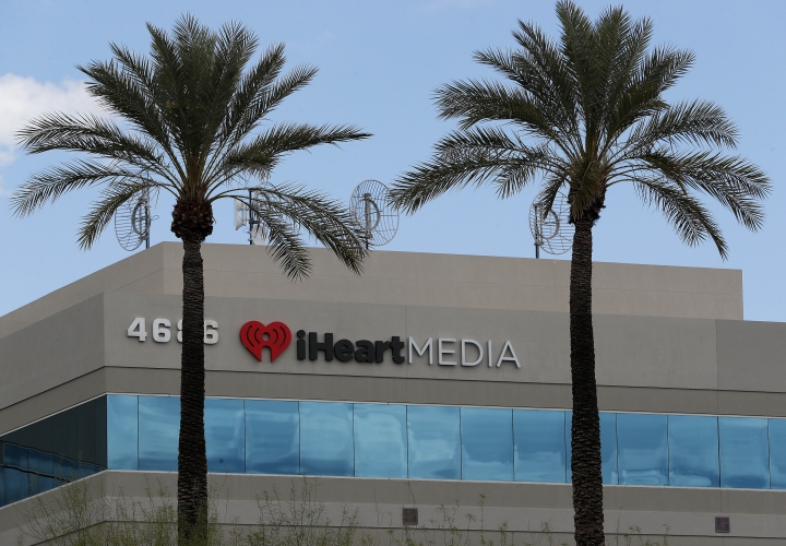 The iHeart Media headquarters is shown Thursday, March 15, 2018, in Phoenix. IHeartMedia, one of the world's largest radio companies, is seeking bankruptcy protection as part of an agreement with its lenders to reduce debt it took on to become a privately held company. The company formerly known as Clear Channel Communications said Thursday that it will operate its businesses as usual while it restructures its finances under Chapter 11 protection to reduce debt by more than $10 billion. (AP Photo/Matt York)