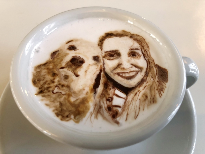 This March 1, 2018, photo shows a portrait of Associated Press writer Ashley Thomas with her dog Sandra, designed atop a cup of cold java by Barista Lee Kang Bin at his coffee shop in Seoul, South Korea. The South Korean barista is charming customers at his coffee shop by drawing intricate artworks on the foamy cream toppings of their drinks. (AP Photo/Dino Hazell)
