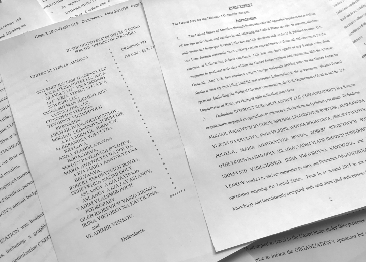 In this March 15, 2018, photo, a portion of the Feb. 16, indictment against Russia's Internet Research Agency is photographed in Washington. In its toughest challenge to Russia to date, the Trump administration accused Moscow of an elaborate plot to penetrate America's electric grid, factories, water supply and even air travel through cyber hacking. The U.S. also hit targeted Russians with sanctions for alleged election-meddling for the first time since President Donald Trump took office. The list of Russians being punished included all 13 indicted last month by special counsel Robert Mueller, a tacit acknowledgement by the Trump administration that Mueller's Russia-related probe has merit. (AP Photo/Jon Elswick)
