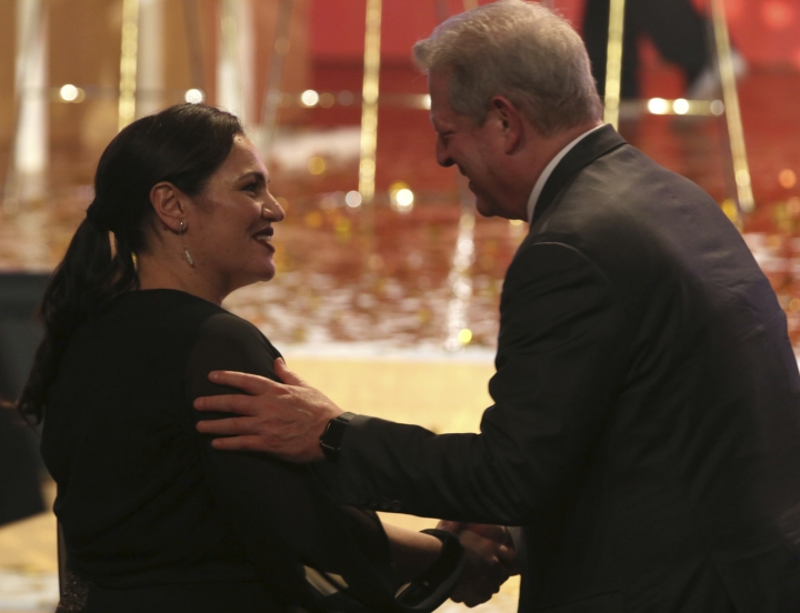 British school teacher Andria Zafirakou, left, shakes hands with former U.S. Vice President Al Gore at a ceremony awarding the Global Teacher Prize in Dubai, United Arab Emirates, Sunday, March 18, 2018. Zafirakou won the highly-competitive $1 million teaching prize on Sunday for her work with inner city children in London, helping students feel welcome and safe in a borough with one of the highest murder rates in the country and where English is frequently spoken as a second language at home. (AP Photo/Jon Gambrell)