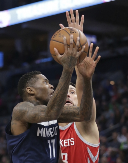 Minnesota Timberwolves guard Jamal Crawford (11) shoots over Houston Rockets forward Ryan Anderson (33) in the second quarter of an NBA basketball game Sunday, March 18, 2018, in Minneapolis. (AP Photo/Andy Clayton-King)
