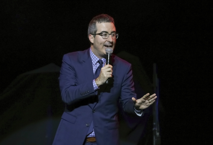 FILE - In this Nov. 7, 2017 file photo, comedian John Oliver performs at the 11th Annual Stand Up for Heroes benefit in New York. Oliver has trolled his way to the top. The HBO host's spoof of a new picture book by the wife and daughter of Vice President Mike Pence was No. 1 on Amazon.com as of midday Monday, March 19, 2018. (Photo by Brent N. Clarke/Invision/AP, File)
