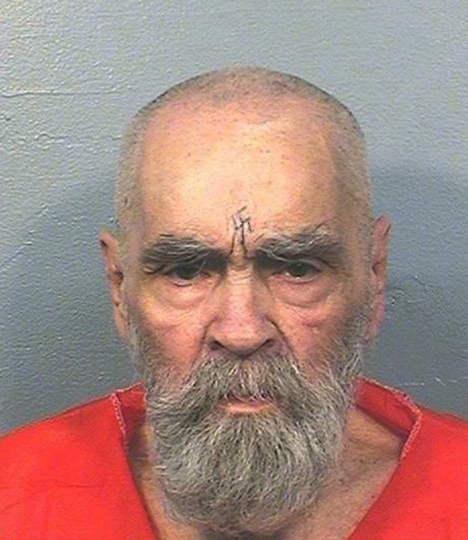 FILE - This Aug. 14, 2017 file photo provided by the California Department of Corrections and Rehabilitation shows Charles Manson. Manson's cremated remains have been scattered nearly four months after the cult leader died in prison. A funeral was held Saturday, March 17, 2018, following a court battle for the 83-year-old's remains. (California Department of Corrections and Rehabilitation via AP, File)