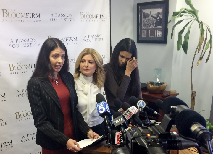 Former model Faviola Dadis, left, reads from a statement at a news conference with her attorney, Lisa Bloom, center, in Los Angeles Monday, March 19, 2018. Dadis, an aspiring actress says she was 17 when actor Steven Seagal sexually assaulted her during a supposed casting session in 2002. At right, Regina Simons who has also accused Seagal of sexual misconduct. Seagal's attorney has not responded to a request for comment about Dadis' allegations. (AP Photo/Andrew Dalton)