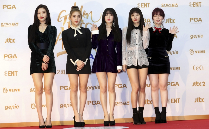 In this Jan. 10, 2018, photo, South Korean popular girl band Red Velvet poses for photographers during the 32nd Golden Disc Awards in Goyang, South Korea. South Korea said on Tuesday, March 20, 2018, it will send a 160-member artistic delegation to North Korea, including about 10 popular K-Pop singers. Red Velvet is also among the South Korean groups. (Lim Tae-hoon/Newsis via AP)