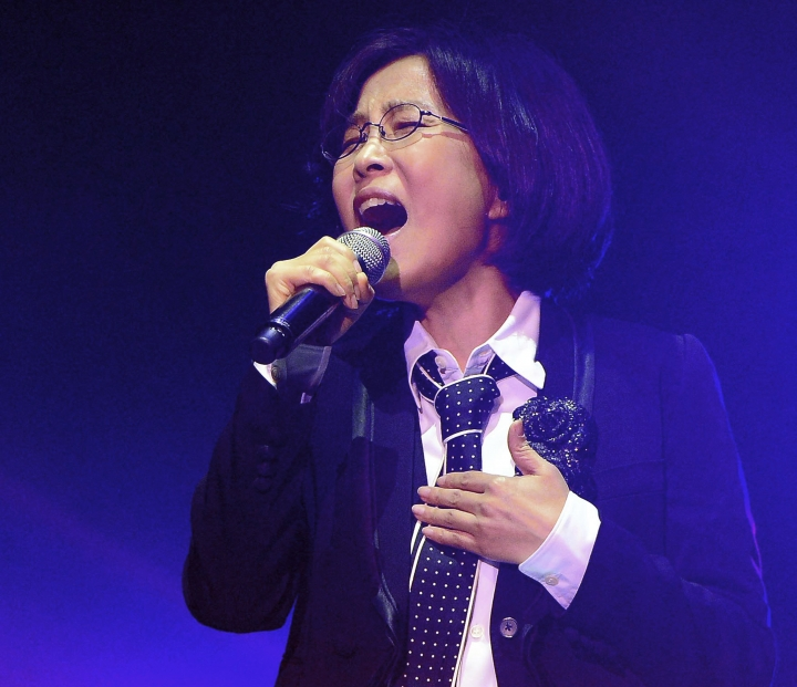 In this March 25, 2014, photo, South Korean Lee Sunhee performs in a concert in Seoul, South Korea. South Korea siad on Tuesday, March 20, 2018, it will send a 160-member artistic delegation to North Korea, including about 10 popular K-Pop singers. Lee is among the delegation. (Park Chan-soo/Newsis via AP)
