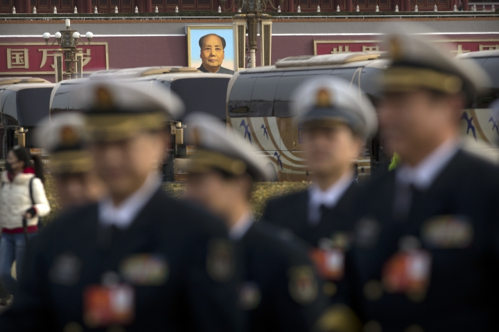 Military delegates arrive for the closing session of China's National People's Congress (NPC) at the Great Hall of the People in Beijing, Tuesday, March 20, 2018. (AP Photo/Mark Schiefelbein)