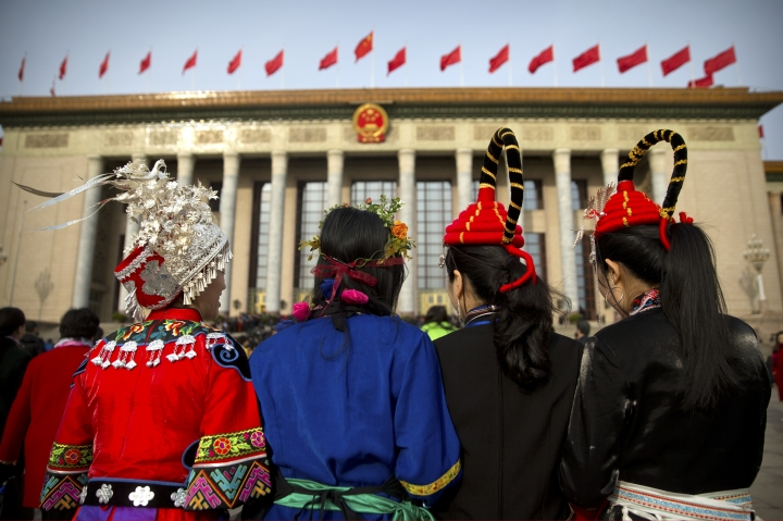 Delegates in ethnic minority dress arrive for the closing session of China's National People's Congress (NPC) at the Great Hall of the People in Beijing, Tuesday, March 20, 2018. (AP Photo/Mark Schiefelbein)