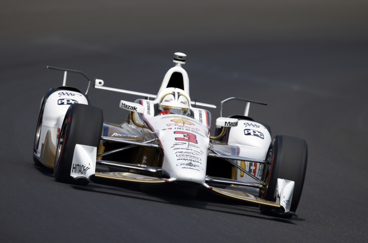 FILE - In this May 26, 2017, file photo, Helio Castroneves, of Brazil, drives through the first turn during the final practice session for the Indianapolis 500 IndyCar auto race at Indianapolis Motor Speedway in Indianapolis. Castroneves was back running laps at Barber Motorsports Park, getting valuable time in a new car and reuniting with his Penske teammates. In another adjustment to his new gig mostly racing sports cars, Castroneves was there Tuesday, March 20, 2018, to get acclimated to the new car not prepping for a return trip in April to the track where he won the inaugural IndyCar race. (AP Photo/Michael Conroy, File)