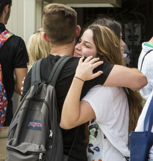 Florida International University sophomore Mariana Maciel embraces a friend after students, faculty and staff observed a moment of silence for the victims of the bridge collapse at the school four days earlier, Monday, March 19, 2018, in Miami. (Daniel A. Varela/Miami Herald via AP)