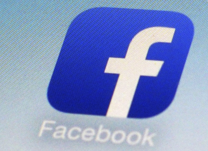 FILE - This Feb. 19, 2014, file photo, shows a Facebook app icon on a smartphone in New York. South Korea's telecoms regulator says it is fining Facebook for illegally limiting user access to its services. The Korea Communications Commission said Wednesday that Facebook should pay 396 million won ($369,400) as a penalty for alleged violations of the communications law from late 2016-2017, following reports it had interfered with some local users' access to Facebook and Instagram. (AP Photo/Patrick Sison, File)