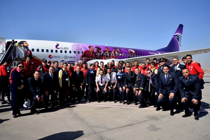 In this Tuesday, March 20, 2018 photo released by Egypt's national Airline, Egypt Air, the Egyptian national football team and Egypt Air staff pose for a photo in front of a specially decorated plane that will take them to Russia for the 2018 FIFA World cup, at Cairo Airport, Egypt. Egypt's first World Cup warmup will be against Portugal in a match that could have two of the most prolific scorers in soccer going up against each other. The Egyptians will be led by Liverpool forward Mohammed Salah. On the other side is Cristiano Ronaldo. (Egypt Air via AP)