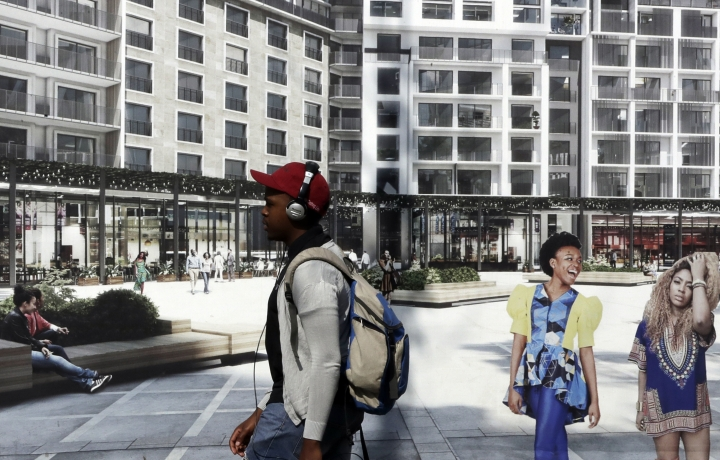 """In this March 20, 2018 photo, a man walks past buildings in Sandton, Johannesburg, South Africa. The blockbuster film """"Black Panther"""" has created a new compelling vision of Africa as a continent of smart, technologically savvy people with cool clothes living in a futuristic city amid stunning landscapes. (AP Photo/Themba Hadebe)"""