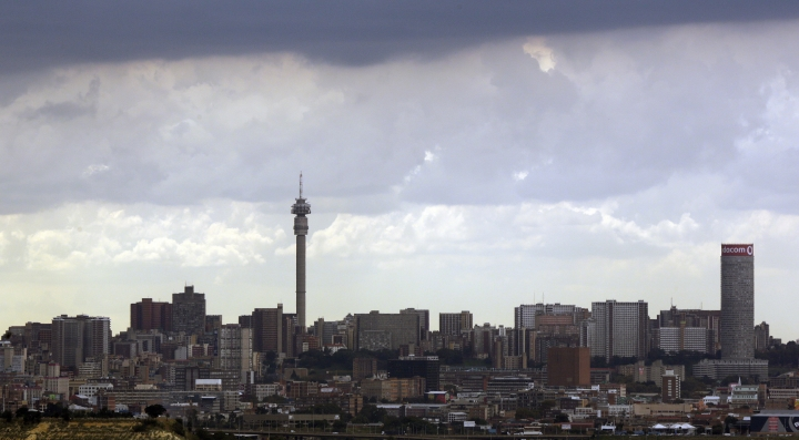 """In this March 20, 2018 photo, Johannesburg's skyline is shown under the clouds in South Africa. The blockbuster film """"Black Panther"""" has created a new compelling vision of Africa as a continent of smart, technologically savvy people with cool clothes living in a futuristic city amid stunning landscapes. (AP Photo/Themba Hadebe)"""