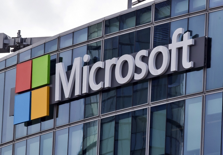 FILE - This April 12, 2016, file photo shows the Microsoft logo in Issy-les-Moulineaux, outside Paris, France. The budget bill before Congress includes an update to federal law that makes clear that authorities with a warrant can obtain emails and other data held by U.S. technology companies but stored on servers overseas. Passage of the Cloud Act probably would end a Supreme Court dispute between Microsoft and the Trump administration over emails the U.S. wants as part of a drug trafficking investigation. (AP Photo/Michel Euler, File)