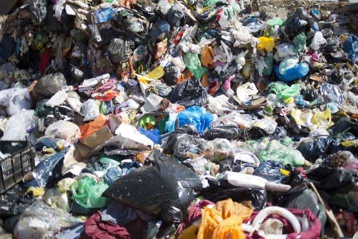 In this Tuesday, March 13, 2018 photo, garbage is piled in a landfill near the UBQ factory in Kibbutz Zeelim. Israeli start-up UBQ says its innovative method to convert garbage into plastics, five years in the making, will revolutionize waste management worldwide and make landfills obsolete. (AP Photo/Ariel Schalit)