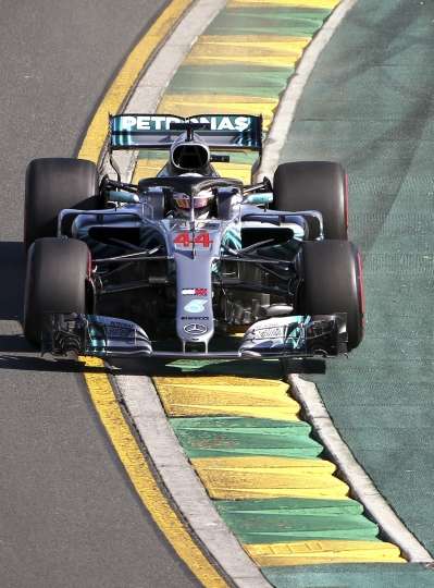 Mercedes driver Lewis Hamilton of Britain runs over the ripple strip in turn 2 during the second practice session at the Australian Formula One Grand Prix in Melbourne, Friday, March 23, 2018. The first race of the 2018 seasons is on Sunday. (AP Photo/Rick Rycroft)