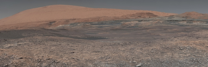 This image provided by NASA, assembled from a series of January 2018 photos made by the Mars Curiosity rover, shows an uphill view of Mount Sharp, which Curiosity has been climbing. Spanning the center of the image is an area with clay-bearing rocks that scientists are eager to explore; it could shed additional light on the role of water in creating Mount Sharp. On Thursday, March 2, 2018, NASA's Mars rover Curiosity marked 2,000 days on the red planet by Martian standards. A Martian sol, or solar day, is equivalent to 24 hours, 39 minutes and 35 seconds. So 2,000 days on Mars equal 2,055 days here on Earth. (NASA/JPL-Caltech/MSSS via AP)