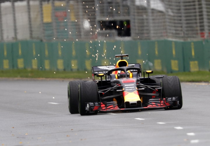 Red Bull driver Daniel Ricciardo of Australia has sparks fly from the back of his car during the practice session at the Australian Formula One Grand Prix in Melbourne, Saturday, March 24, 2018. The first race of the 2018 seasons is on Sunday. (AP Photo/Asanka Brendon Ratnayake)