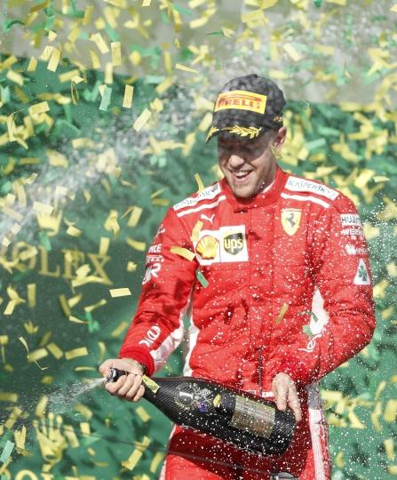 Ferrari driver Sebastian Vettel of Germany sprays champagne after winning the first race of the season at the Australian Formula One Grand Prix in Melbourne, Sunday, March 25, 2018. (AP Photo/Asanka Brendon Ratnayake)