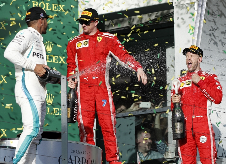 Ferrari driver Sebastian Vettel, right, of Germany his teammate, Kimi Raikkonen of Finland and Mercedes driver Lewis Hamilton, left, of Britain, spray champagne after the first race of the season at the Australian Formula One Grand Prix in Melbourne, Sunday, March 25, 2018. Vettel won ahead of Hamilton while Raikkonen finished 3rd. (AP Photo/Asanka Brendon Ratnayake)
