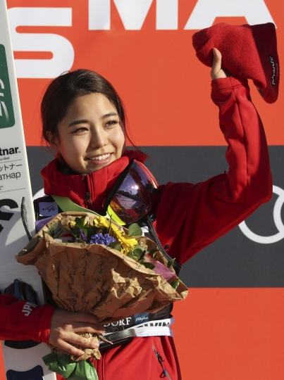 Japan's Sara Takanashi celebrates after she won the Ladies' Ski Jumping World Cup in Oberstdorf, Germany, Saturday, March 24, 2018. (Karl-Josef Hildenbrand/dpa via AP)