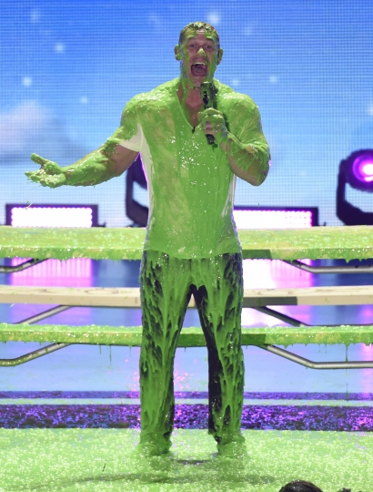 Host John Cena gets slimed onstage at the Kids' Choice Awards at The Forum on Saturday, March 24, 2018, in Inglewood, Calif. (Photo by Chris Pizzello/Invision/AP)