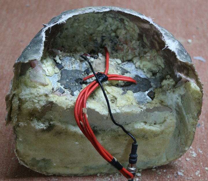 In this undated photograph provided by Conflict Armament Research, an independent London-based group that researches battlefield weaponry, an explosive disguised as a rock is on display in Yemen. Roadside bombs disguised as rocks in Yemen bear similarities to others used by Hezbollah in southern Lebanon and by insurgents in Iraq and Bahrain, suggesting at the least an Iranian influence in their manufacturing, a report released Monday, March 26, 2018, by Conflict Armament Research alleges. The report comes comes as the West and United Nations researchers accuse Iran of supplying arms to Yemen's Shiite rebels known as Houthis, who have held the country's capital since September 2014. (Tim Michetti/Conflict Armament Research via AP)