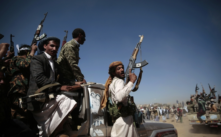FILE - In this Jan. 3, 2017, file photo, newly recruited Shiite fighters, known as Houthis, mobilize to fight pro-government forces, in Sanaa, Yemen. Roadside bombs disguised as rocks in Yemen bear similarities to others used by Hezbollah in southern Lebanon and by insurgents in Iraq and Bahrain, suggesting at the least an Iranian influence in their manufacturing, a report released Monday, March 26, 2018, by Conflict Armament Research alleges. The report comes comes as the West and United Nations researchers accuse Iran of supplying arms to Houthis, who have held the country's capital since September 2014. (AP Photo/Hani Mohammed, File)