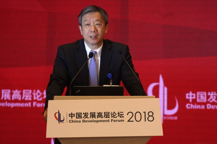 China's Central Bank Governor Yi Gang speaks at the China Development Forum at the Diaoyutai State Guesthouse in Beijing, Sunday, March 25, 2018. Yi outlined sweeping plans Sunday to rein in rising debt and financial risk, but expressed confidence that Beijing can prevent potential dangers. (AP Photo/Emily Wang)