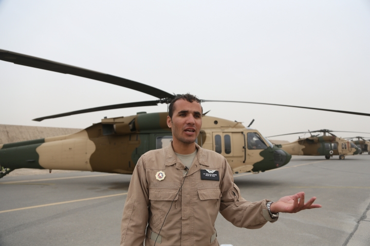 In this Sunday, March 18, 2018 photo, Lt. Abdul Hadi Reeshad, 24, new Afghan pilot speaks during an interview with The Associated Press at Kandahar Air Field, Afghanistan. The U.S. military has been flying UH-60 Black Hawk helicopter missions in Afghanistan for years, but the storied aircraft will soon take to the country's battlefields manned by pilots and crews from the Afghan military. Reeshad who just returned from training in the U.S., was ready to start the final phase of his Black Hawk training. (AP Photo/Rahmat Gul)
