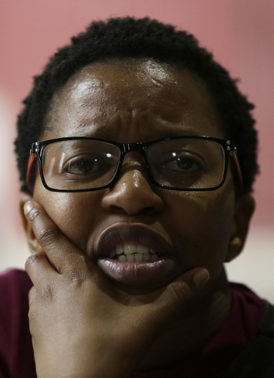 In this photo taken Thursday, March 22, 2018, Nomvula Nonjabe, a relative of one of the survivors of the Esidimeni tragedy, speaks during an interview with the Associated Press in Johannesburg. The deaths of 144 psychiatric patients in South Africa as the result of gross mistreatment have shocked the country and raised troubling questions about the government's commitment to its most vulnerable citizens more than 20 years after the end of apartheid. (AP Photo/Themba Hadebe)