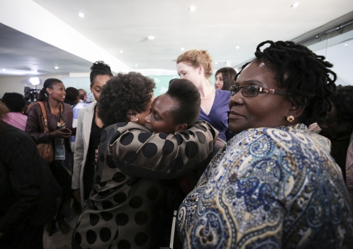 In this photo taken Monday, March 19, 2018, family members of victims of the Esidimeni tragedy, hug and wish one another well at the end of an enquiry into the tragedy in Johannesburg. The deaths of 144 psychiatric patients in South Africa as the result of gross mistreatment have shocked the country and raised troubling questions about the government's commitment to its most vulnerable citizens more than 20 years after the end of apartheid. (AP Photo)