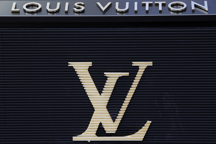 FILE - In this Sept. 20, 2017, file photo, the logo of Louis Vuitton, a fashion house and luxury retail company is pictured on their store on the Champs Elysees Avenue in Paris, France. Louis Vuitton has named Kanye West collaborator Virgil Abloh as its new men's wear artistic director. (AP Photo/Francois Mori, File)
