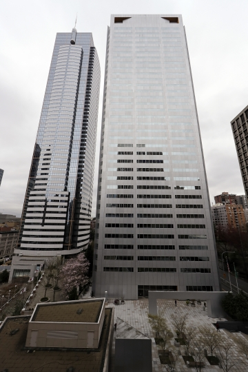 One Union Square, right, the downtown Seattle building that houses the Russian consulate on the 25th floor, is seen Monday, March 26, 2018, in Seattle. The United States and more than a dozen European nations kicked out Russian diplomats on Monday and the Trump administration ordered Russia's consulate in Seattle to close, as the West sought joint punishment for Moscow's alleged role in poisoning an ex-spy in Britain. (AP Photo/Elaine Thompson)