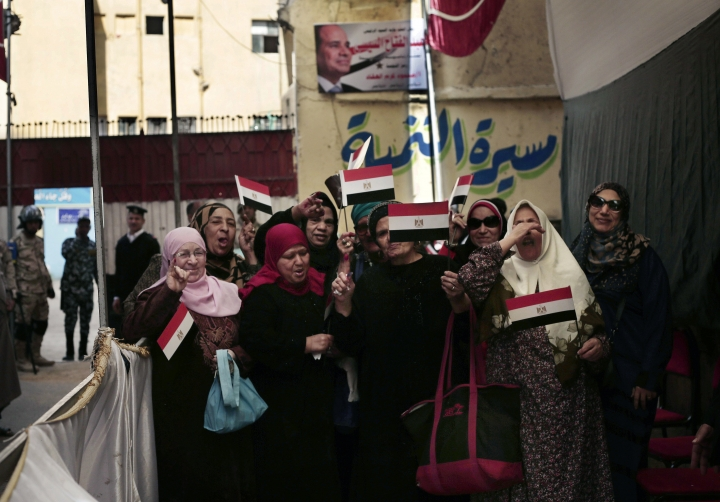 Women pose for a photograph after voting during the first day of the presidential election outside a polling site in Cairo, Egypt, Monday, March 26, 2018. Polls opened on Monday in Egypt's presidential election with the outcome — a second, four-year term for President Abdel-Fattah el-Sissi — a foregone conclusion, in what is seen by critics as a signal of the country's return to the authoritarian rule that prevailed since the 1950s. (AP Photo/Nariman El-Mofty)