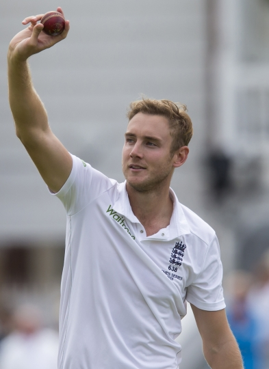 FILE - In this Thursday, Aug. 6, 2015, file photo, England's Stuart Broad raises the ball after taking 5 wickets for 19 runs on the first day of the fourth Ashes test cricket match between England and Australia at Trent Bridge cricket ground in Nottingham, England. England fast bowlers including Broad faced accusations of ball tampering when they rubbed the ball on the ground with their spikes during a test match against South Africa at Cape Town. (AP Photo/Jon Super, File)