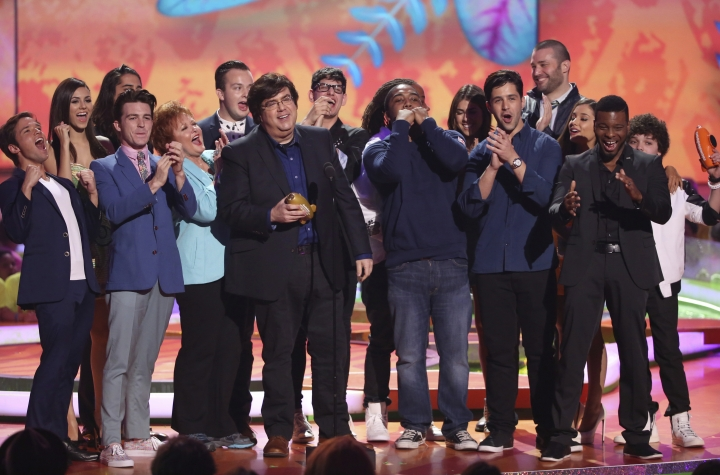 "FILE - In this March 29, 2014, file photo, Dan Schneider, center, accepts the lifetime achievement award at the 27th annual Kids' Choice Awards at the Galen Center in Los Angeles. Nickelodeon is breaking ties with Schneider, the creator of some of its top shows, including ""Henry Danger"" and ""iCarly."" In a joint statement, Nickelodeon, Schneider and his production company, Schneider's Bakery, agreed it ""is a natural time"" to pursue other opportunities and projects since several Schneider's Bakery projects are wrapping up. (Photo by Matt Sayles/Invision/AP, File)"